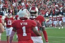 Indiana quarterback Tre Roberson congratulates teammate Shane Wynn after Wynn's second touchdown catch of the day.