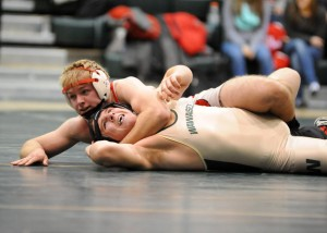Goshen's Evan Smith controls the match against Wawasee's James Hobbick in the 182-pound match. (Photos by Mike Deak)