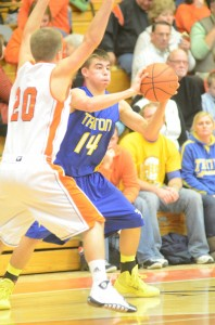 Triton's Jordan Anderson is well defended by Nate Pearl of Warsaw Friday night.