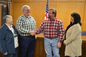 Dennis Darr, second from left, president of the Turkey Creek Township Advisory Board, welcomes newly elected board member John Heckaman. Heckaman was elected at a township precinct caucus Tuesday evening. On the far left is Barb Griffith, township trustee while on the far right is board member Kim Cates. (Photo by Deb Patterson)