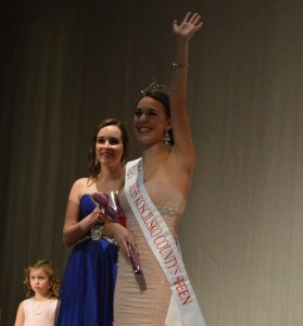 Alexandria Fiscus waives to the crowd after being crowned Miss Kosciusko County's Outstanding Teen 2014. Breonna Cole and Alyssa Hochstetler are shown to the left