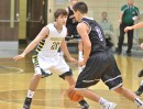 Jake Hutchinson guards NorthWood's Braxton Linville.