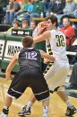 Wawasee's Sam Clark looks for a teammate over the tight defense of NorthWood's Kyle McCoy.