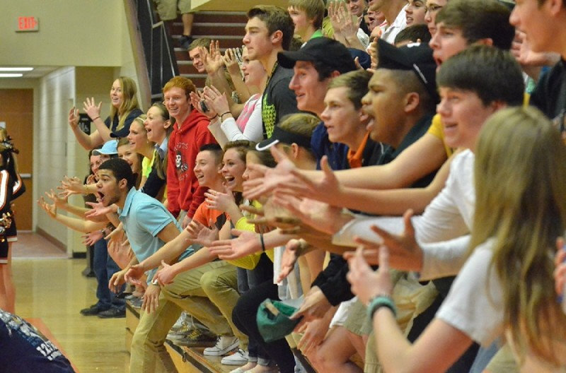 Warsaw students react in response to Snider head coach Tony Sumpter as the cheer block mocked his every move during the third quarter of Saturday's game. (Photos by Nick Goralczyk)