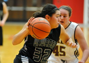 Allissa Flores of Wawasee dribbles past Brebeuf's Gracie Medcalfe.