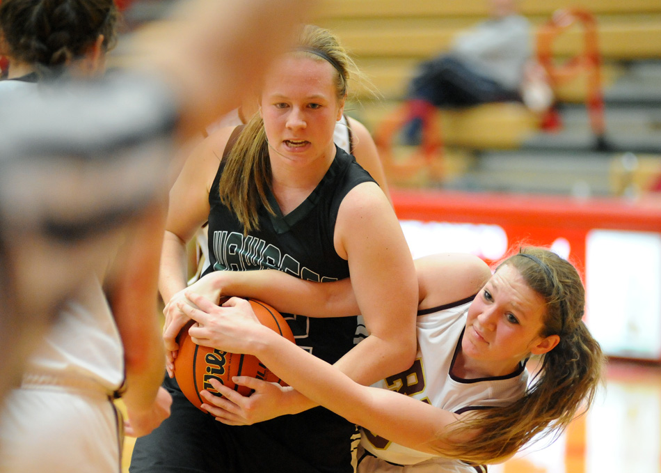 Hannah Haines of Wawasee and Gracie Medcalfe of Brebeuf fight for a loose ball.