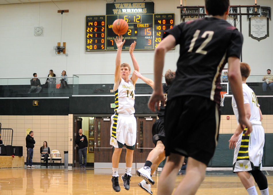 Gage Reinhard of Wawasee hoists a three-point shot attempt against Columbia City.