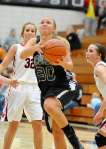 Kylee Rostochak of Wawasee drives in for a layup against NorthWood.