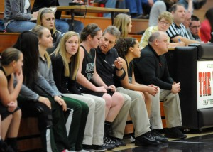 Wawasee head coach Kem Zolman takes a moment to work on some teaching techniques with Katlyn Kennedy.