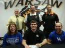 WCHS senior Seth Fouts will attend Kentucky to compete for their track and field team. The standout shot putter is flaked by his mother Cheryl and brother Chad. In back are WCHS Athletic Director Dave Andson, WCHS boys track head coach Matt Thacker and WCHS throws coach Leonard Wells (Photo provided)