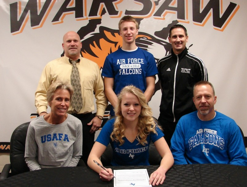 WCHS senior Claire Hickerson will continue her pole vaulting career at the Air Force Academy. Hickerson is flanked by her parents Jo and Bryan. In back are WCHS Athletic Director Dave Anson, Tommy Hickerson and WCHS girls track and field and cross country coach Scott Erba (Photo provided)