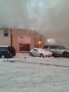 At least three fire departments are at Medina's body shop in Milford this morning where a blaze broke out just after 7 a.m. trapping two people in an upstairs apartment. (Photo by Deb Patterson)