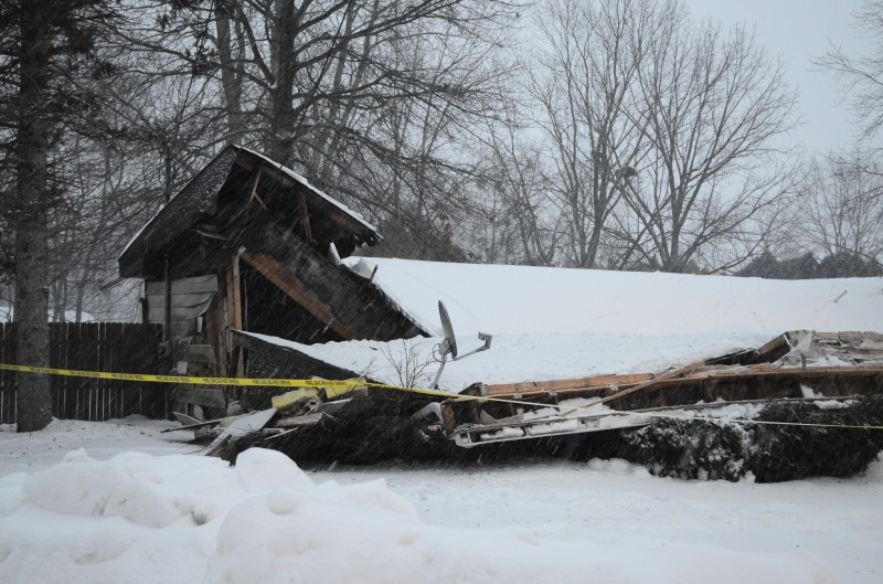 A vacant house in the Herscher Addition collapsed Monday night, presumable under the weight of heavy snow. (Photos by Stacey Page)