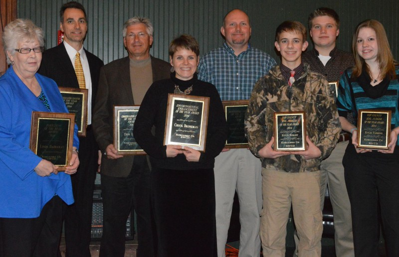 In front are Linda Hathaway, Lyn Crighton who accepted the award for Chuck Brinkman, Kevin Schlipf, and Kylie Flemming with Tom Ray, Don Buhrt, Shawn Krull and Jake Templin in back. These individuals received various awards at the Annual Meeting of Kosciusko County SWCD tonight. (Photo by Deb Patterson)
