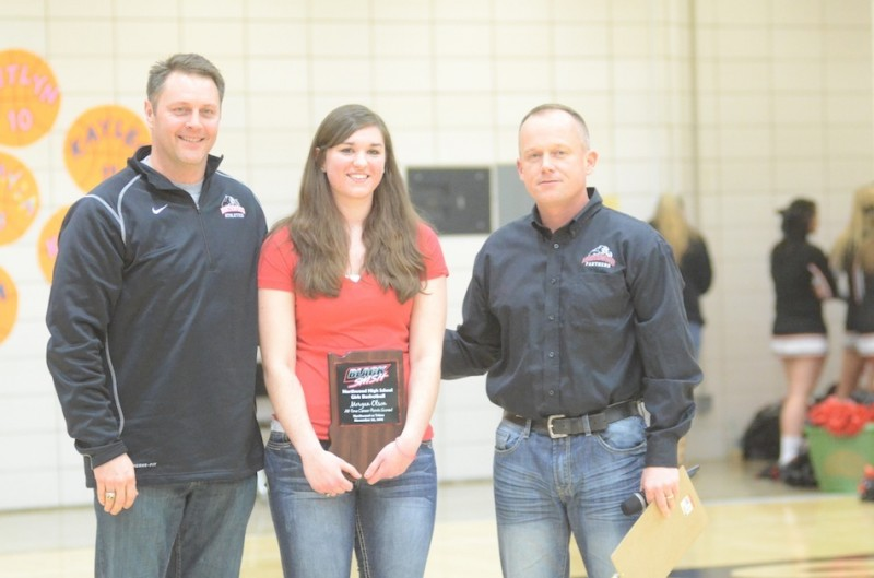 NorthWood senior Morgan Olson was honored recently for being the school's all-time leading scorer for girls basketball. Olson is show above with (from left) NorthWood principal David Maugel and NorthWood athletic director Norm Sellers.