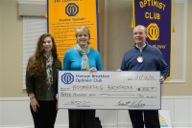 (From left) Joelle Schram and Tracey Akers accept a check for $300 from Rick Kerlin, representing the Optimist Club.  (Photo provided)