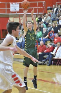Gage Reinhard hits one of Wawasee's seven three-pointers on the night.