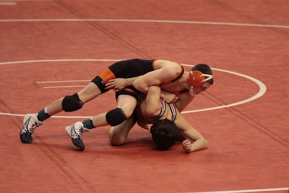 Kyle Hatch of Warsaw competes Saturday in a quarterfinal match at Bankers Life Fieldhouse in Indianapolis. Hatch went on to place eighth at 106.