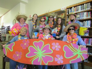 Milford Library staff members are ready for the heat wave! Seated (From left) Dorothy Haney, Sharon Fouts, Mim Eberly.  Standing  are Shari Lambert, Malea Vanlaningham, Heather Pickens, Julie Frew, Heidi Warstler and Maureen Haab. (Photo provided)