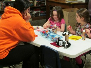 """Candace Shepherd and Brookelynn Penrod decorate sleeping bags for their penguin friends during our """"Warm & Fuzzy"""" story time. (Photo provided)"""