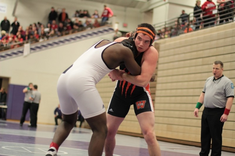 Warsaw senior Anthony Hendrickson competes in a first-round semi state match Saturday at Merrillville.