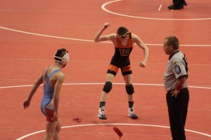 Kyle Hatch celebrates his first-round win at the State Finals in Indianapolis.