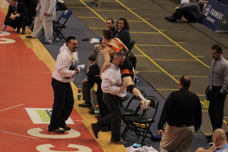 Warsaw freshman Kyle Hatch is carried in celebration by his father/coach Dan Hatch following his 13-12 win at the State Finals Friday night in Indianapolis (Photos provided by Scott Gareiss)