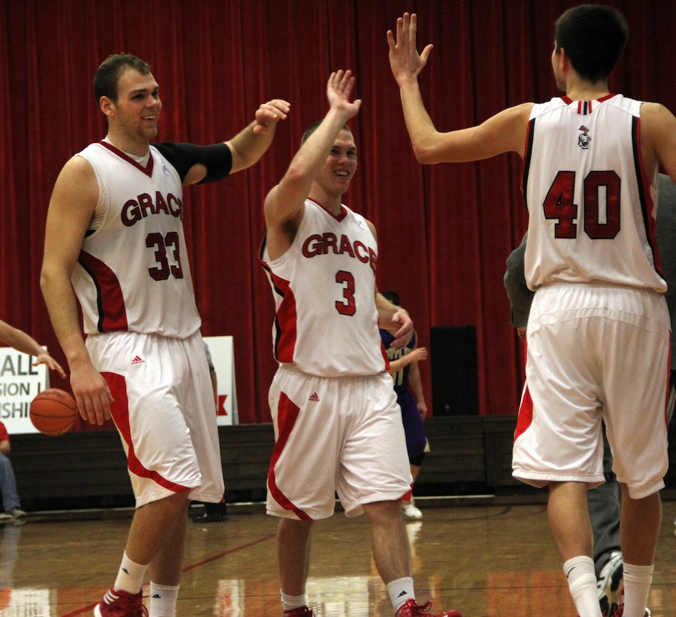 Greg Miller (far left) and Logan Irwin (center) of Grace College earned conference accolades (Photo provided by Grace College Sports Information Department)