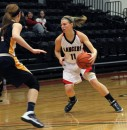Sophomore guard Gabby Bryant makes a move for Grace College during a 65-61 win over Spring Arbor Thursday night (Photo provided by Grace College Sports Information Department)