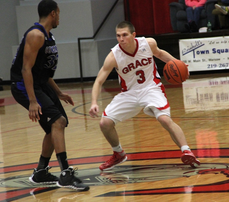 Grace College sophomore guard Logan Irwin makes a move Saturday. The former Whitko High School star had 13 points as the Lancers topped No. 11 St. Francis 76-73 in Winona Lake (Photo provided by Grace College Sports Information Department)