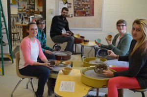 Shown with a few of the bowls are, clockwise, students Ruby Minnick and Kaine Pierce and Whirledge, along with students Christopher Oesch and Jaclyn Miller.