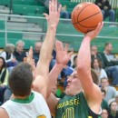 Alex Clark puts up a seriously contested shot over Northridge's Nate Ritchie. (Photos by Nick Goralczyk)