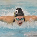Bre Robinson flies down the lane during the 100 butterfly. Robinson won the event with a time of 54.60.