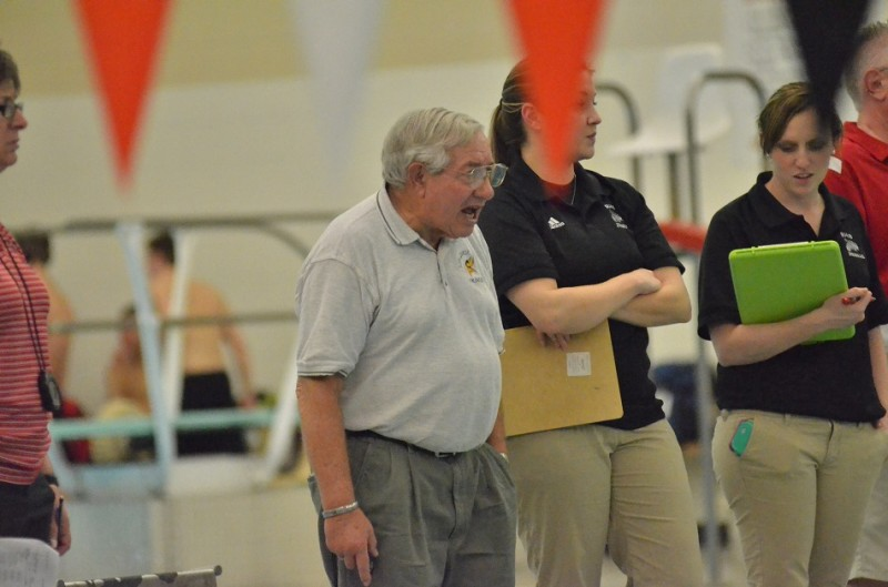 Viking head coach Buddy Busby encourages Tanner Neeley during the 100 backstroke on Thursday night.