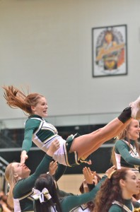 Warrior junior Chelsea Kidd cradles after leading the Wawasee crowd in a cheer. (Photo by Nick Goralczyk)