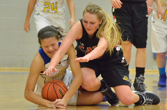 Mallorie Jennings of Triton and Oregon-Davis' Halley Collings hold nothing back when diving for a loose ball in the first half. (Photos by Nick Goralczyk)