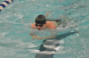 Tanner Neeley competes in the 100 breaststroke.