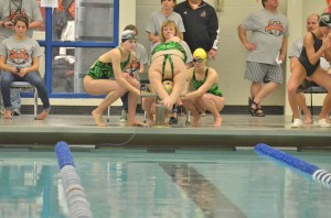 Valley's 400 relay team watches its first swimmer take off.