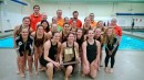 The Warsaw girls swim team proudly displays their sectional championship trophy Saturday (Photo provided)
