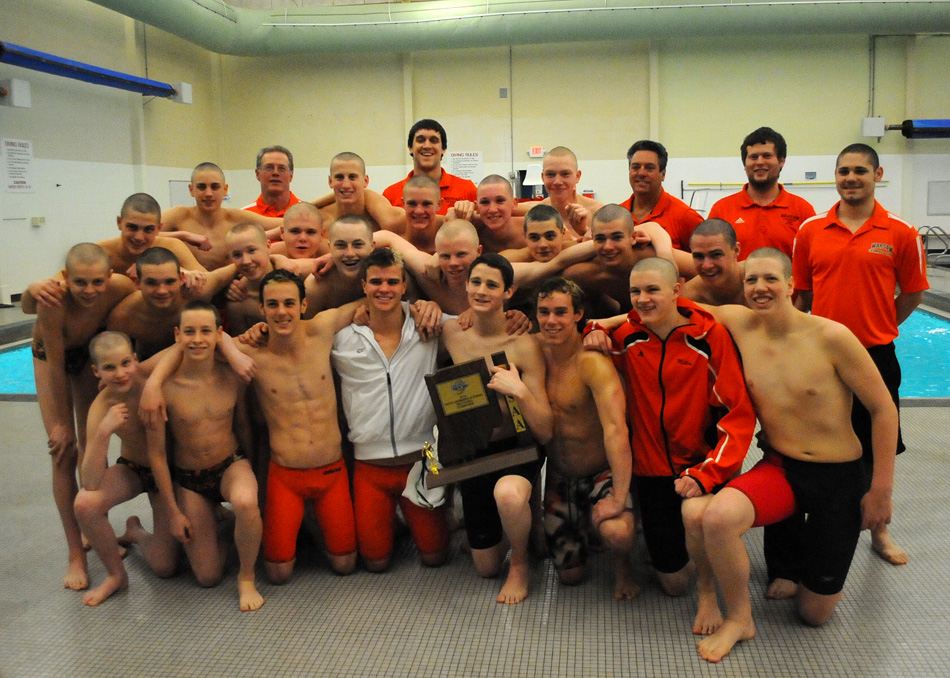 Warsaw's boys swim team celebrates its seventh consecutive sectional championship with its win Saturday at the Warsaw Boys Swimming Sectional. (Photos by Mike Deak)