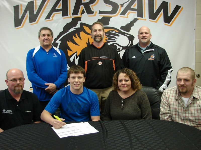 WCHS senior Caleb Heckaman has signed to play baseball at Ancilla College. Shown above in front (from left) are Chad Heckaman, Caleb Heckaman, LeAnn Brand and Nick Brand. In back are Ancilla College baseball coach Joe Yonto, WCHS baseball coach Mike Hepler and WCHS athletic director Dave Anson (Photo provided)