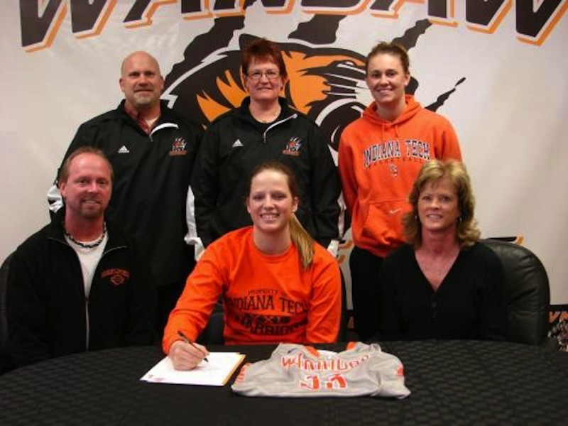 Warsaw senior Nikki Grose signed Friday to play basketball at Indiana Tech. Grose is shown above with her parents Alan and Tracey. In back are WCHS Athletic Director Dave Anson, WCHS girls basketball coach Michelle Harter and Indiana Tech coach Jessica Wiggins (Photo provided)