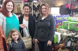 From left are Andrea Compson, winner of a Coach purse; Amy Pixton, B.A.B.E. Program Coordinator; Melissa Ryan, owner The Boutique Exchange. (Photo provided)
