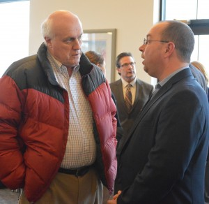 Dr. Kenneth Pennington talks with Curt Nisley, Republican primary candidate for State Rep. District 22 at the Syracuse-Wawasee Chamber Meet the Candidate Night. US Rep. District 2 Democratic Candidate Joe Bock is shown in the background. (Photo by Deb Patterson)