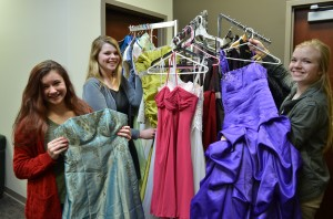 From left are Lacey Lisenbee, Cailin Clay and Ashlyn Vitoux. The girls are coordinating this year's Glass Slipper event that will fit county high school girls with free prom dresses and accessories. (Photo by Stacey Page)