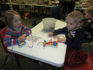 Shelby Miller and Charlie Miller practice tying shoes and color a pair of dancing shoes during Winter Story Time, Winter Waltz (Photo provided)
