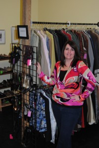 """The Posh Frog is celebrating its one-year anniversary. A women's consignment store, it will host an open house April 1 at its downtown Warsaw location. Pictured is owner and """"boss frog"""" Gretchen Kellems inside the store."""