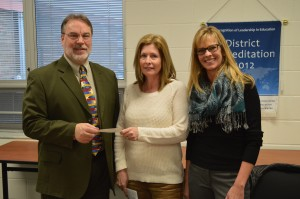 Dr. Tom Edington, left, superintendent of the Wawasee Community School Corp., accepted a donation check in the amount of $1,800 from Paula Ratliff, middle, representing Women of Today. Also shown is Rebecca Linnemeier, president of the Wawasee school board.