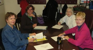 The Friends of the Library Publicity Committee is busy planning ways to get the word out about the upcoming FOL Book Sale March 20-22. Pictured is (from left): Juanita Robinett, Kelly Shock, Kay Dabler and Faye Myers. (Photo provided)