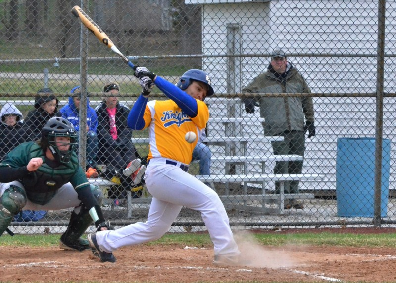 Noah Hamilton hits a ball foul early in Monday's 17-10 win for East Noble. Hamilton had one RBI and scored three runs for the Knights. (Photos by Nick Goralczyk)